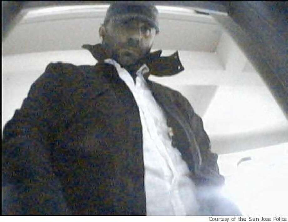 A surveillance camera photo from an ATM machine in the South Bay shows a suspect making withdrawals using counterfeit cards containing debit card information stolen from a payment terminal at an Arco gas station in San Jose, Calif. Photo: Courtesy Of The San Jose Police