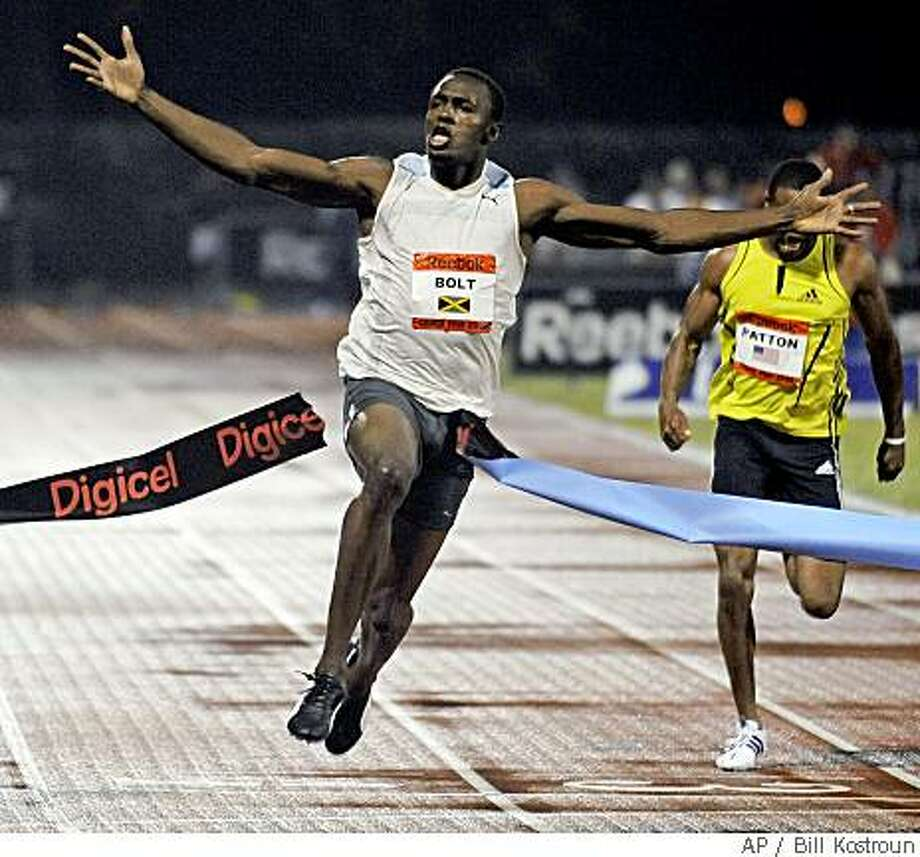 Jamaica's Usain Bolt breaks the tape with a world record time of 9.72 seconds in the men's 100 Meter sprint at the Reebok Grand Prix athletics meet Saturday night, May 31, 2008 at Icahn Stadium in New York. The Associated Press photo by Bill Kostroun Photo: Bill Kostroun, AP