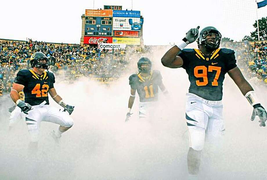 California Shea Mclintyre (42), Sean Cattouse (11)  and Cameron Jordan lead the Golden Bears onto the field for their game with the Arizona State Sun Devils. Cal defeated ASU in Berkeley 24-14.  Saturday, Oct. 4, 2008 Photo: Lance Iversen, The Chronicle