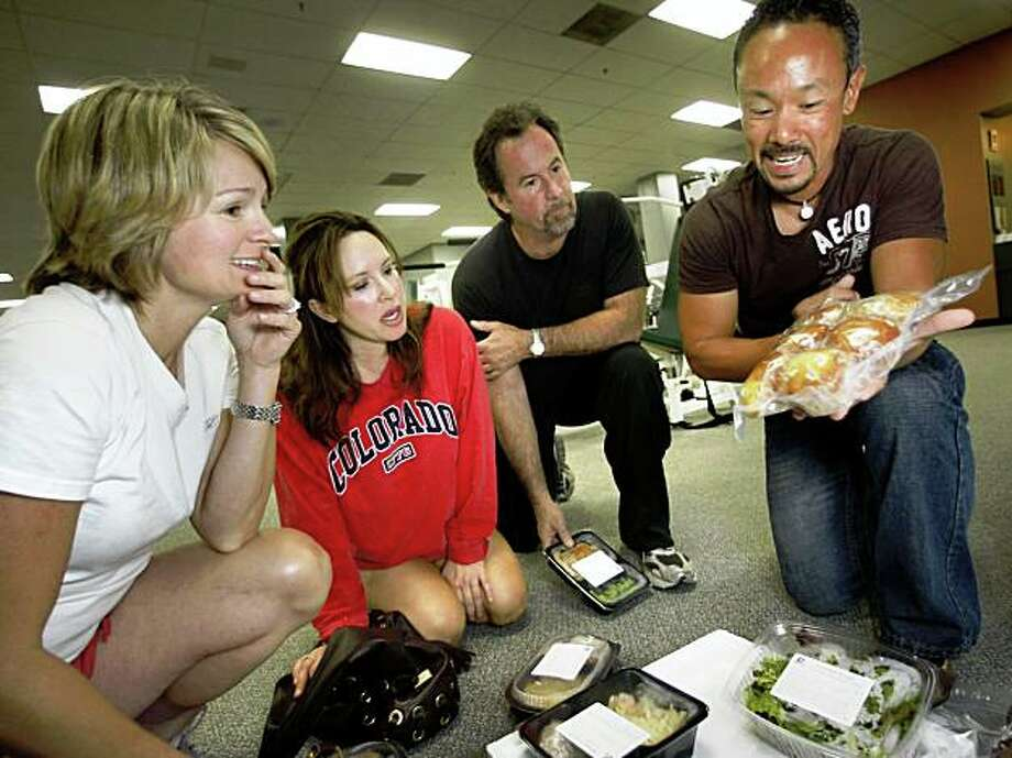 Lyndon Bell (right), from Diet to Go, shows muffins and meals in his diet program as Gaylene Parker (left),  Cecilia Marosi-Hopkins (middle) and David Ferrari (middle, right)  embark on a 6-week diet and fitness program, complete with weekly weigh-ins, to see visible changes as they meet in Menlo Park, Calif., on Thursday, October 1, 2009. Photo: Liz Hafalia, The Chronicle
