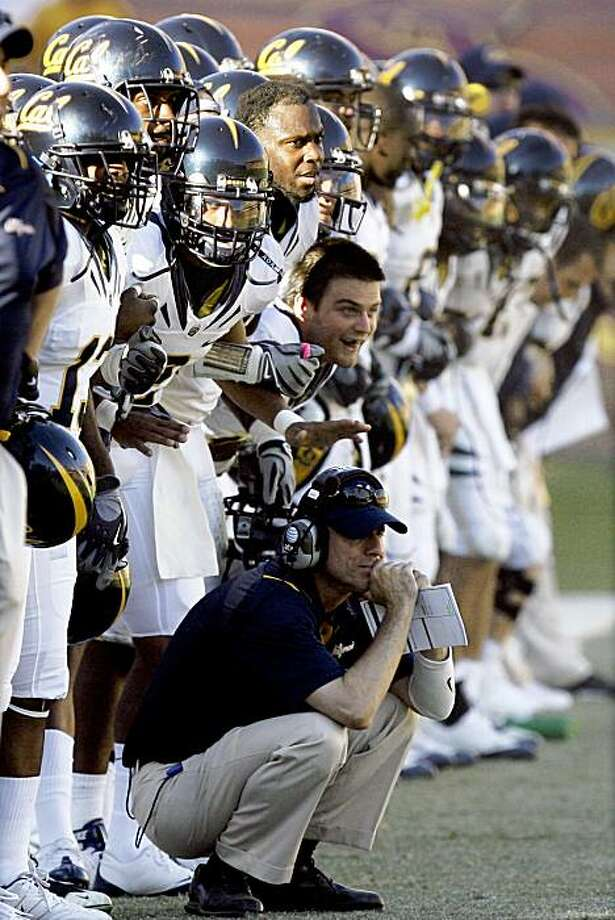 California players lock arms as they watch their place kicker, Giorgio Tavecchio, kick the game-winning field goal against Arizona State in the fourth quarter of an NCAA college football game Saturday, Oct. 31, 2009, in Tempe, Ariz. California won 23-21. (AP Photo/Paul Connors) Photo: Paul Connors, AP