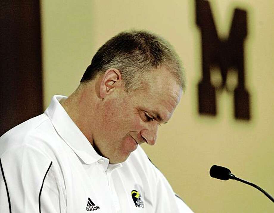 Michigan football coach Rich Rodriguez addresses the media in Ann Arbor, Mich. on  Monday, Aug. 31, 2009.  Rodriguez said Monday that his football program has abided by NCAA rules, despite allegations from anonymous players and former players who say the team has practiced far beyond the time allowed. At a news conference in Ann Arbor, Rodriguez became emotional and had to gather himself several times with glassy eyes as he denied any wrongdoing. (AP Photo/Detroit Free Press, Andre J. Jackson) ** DETROIT NEWS OUT ** Photo: Andre J. Jackson, AP