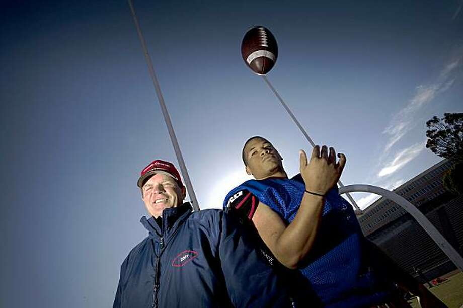 San Francisco City College Quarterback Darius Bell poses with his coach George Rush on the field of San Francisco City College October 26, 2009 in San Francisco, Calif. (Photograph by David Paul Morris/Special to the Chronicle) Photo: David Paul Morris, Special To The Chronicle