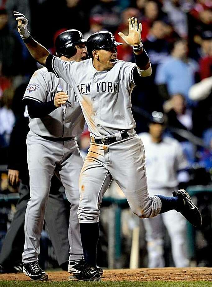 PHILADELPHIA - NOVEMBER 01:  (L-R)  Mark Teixeira #25 and Alex Rodriguez #13 of the New York Yankees celebrate after they scored on a 2-run single by Jorge Posada #20 in the top of the ninth inning against the Philadelphia Phillies in Game Four of the 2009 MLB World Series at Citizens Bank Park on November 1, 2009 in Philadelphia, Pennsylvania.  (Photo by Jeff Zelevansky/Getty Images) Photo: Jeff Zelevansky, Getty Images