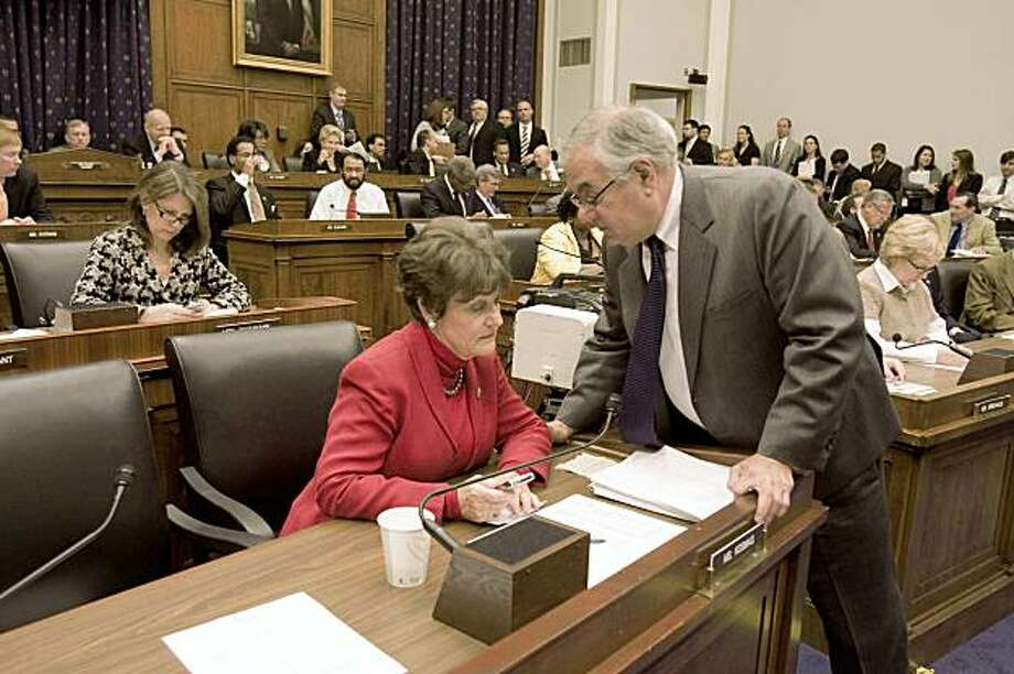 House Financial Services Committee Chairman Rep. Barney Frank, D-Mass., right, confers with committee member Rep. Suzanne Kosmas, D-Fla. on Capitol Hill in Washington, Wednesday, Oct. 21,2009, during the committee's  markup on the financial overhaul bill . (AP Photo/Harry Hamburg) Photo: Harry Hamburg, AP