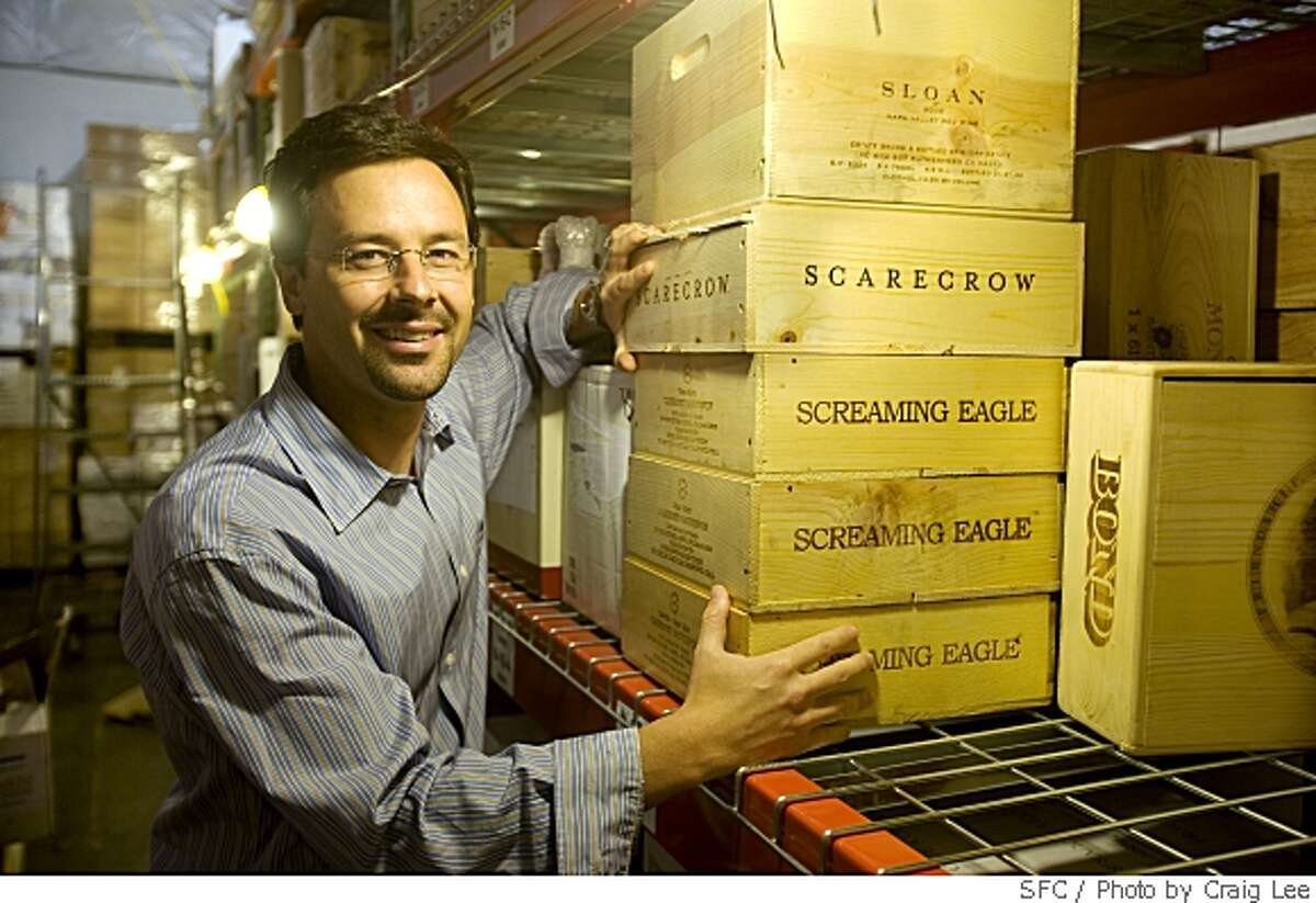 Shaun Bishop, president of WineCommune, with some cult wine boxes his company auctions and sells, in Oakland, Calif., on May 19, 2008.Photo by Craig Lee / The San Francisco Chronicle