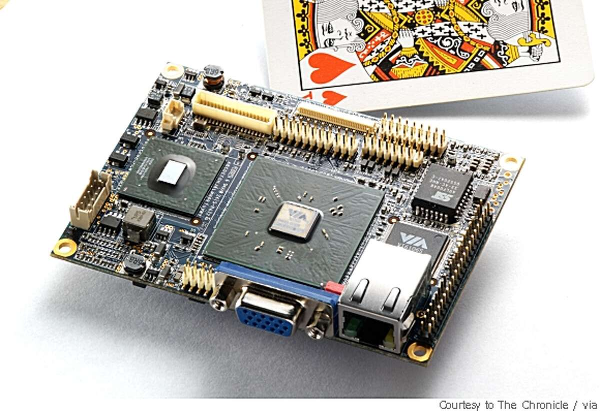 An energy-efficicient Via microprocessor surrounded by its supporting circuitry.