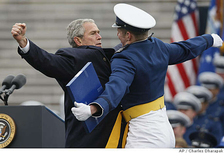 *** SECOND IN A SERIES OF THREE *** President Bush and graduate Theodore Shiveley from Plano, Texas, bump chests at the United States Air Force Academy graduation ceremony in Colorado Springs, Colo., Wednesday, May 28, 2008. (AP Photo/Charles Dharapak) Photo: Charles Dharapak, AP