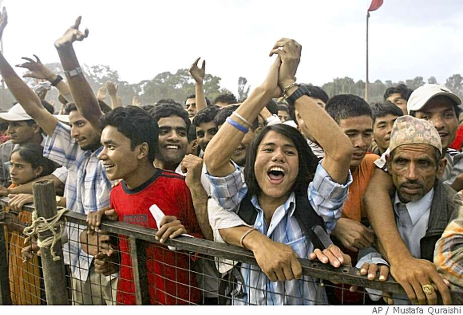 Nepalese celebrate the end of monarchy, ahead of becoming the worlds newest republic, in Katmandu, Nepal, Tuesday, May 27, 2008. An assembly charged with ending 239 years of royal rule was sworn in amid tight security, even as a string of bombings hit Katmandu over the past two days, all apparently aimed at pro-republic politicians and activists. (AP Photo/Mustafa Quraishi) Photo: Mustafa Quraishi, AP