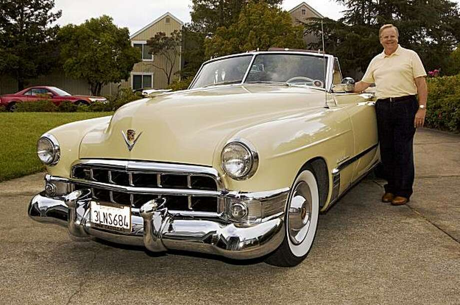 While 1948 was the year GM introduced its nowfamous Cadillac fins patterned after the twin-boom rudders of P-38 Lightning aircraft, it was the '49 that had the first 331 overhead-valve V8 engine. Charles Thompson and his 1949 Cadillac Series 62 Convertible, at his home in Bahia subdivision, Novato, CA on September 12, 2009 Photo: Stephen Finerty