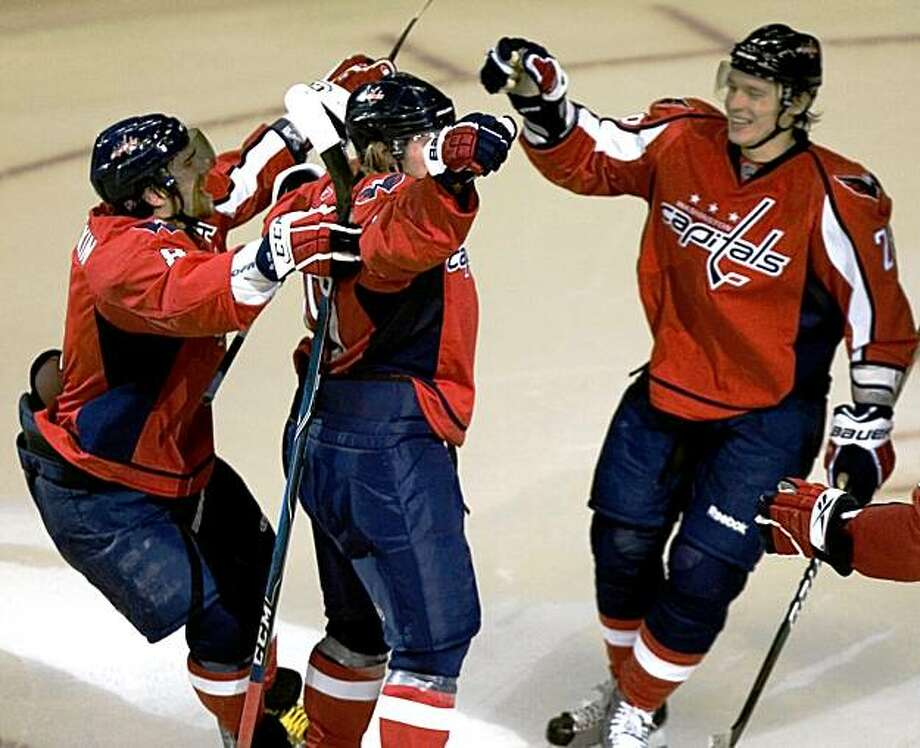 Washington Capitals' Nicklas Backstrom, center, of Sweden is congratulated by teammates  Alex Ovechkin (8) Alexander Semin (28)  both of Russia after scoring a goal during the second period of an NHL hockey game against the Philadelphia Flyers, Tuesday, Oct. 27, 2009, in Washington.   (AP Photo/Manuel Balce Ceneta) Photo: Manuel Balce Ceneta, AP