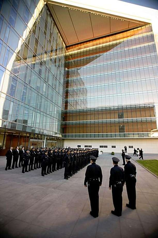 In this photo taken Oct. 23, 2009,  LAPD Command staff and officers of the Robbery-Homicide Division stand at attention to practice before Chief William Bratton at the new Los Angeles Police Administration Building in downtown Los Angeles. (AP Photo/Los Angeles Times, Al Seib) ** NO FORNS; NO SALES; MAGS OUT; ORANGE COUNTY REGISTER OUT; LOS ANGELES DAILY NEWS OUT; VENTURA COUNTY STAR OUT; INLAND VALLEY DAILY BULLETIN OUT; SAN BERNARDINO SUN OUT; MANDATORY CREDIT; TV OUT; INTERNET OUT ** Photo: Al Seib, AP