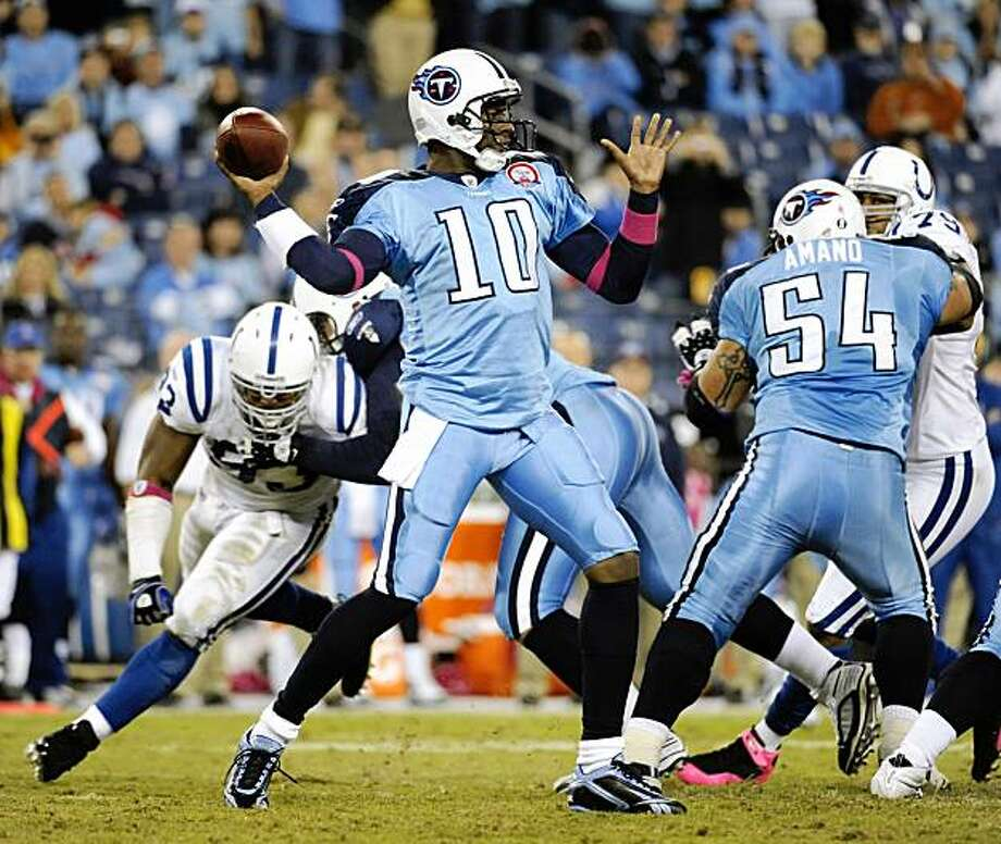 FILE- In this Oct. 11, 2009, file photo, Tennessee Titans quarterback Vince Young (10) passes against the Indianapolis Colts during the fourth quarter of an NFL football game in Nashville, Tenn. The owner of the Tennessee Titans wants to see more of Vince Young. He's reportedly getting just that with the winless Titans making a change at quarterback from veteran Kerry Collins back to the 2006 Offensive Rookie of the Year. (AP Photo/John Russell, File) Photo: John Russell, AP