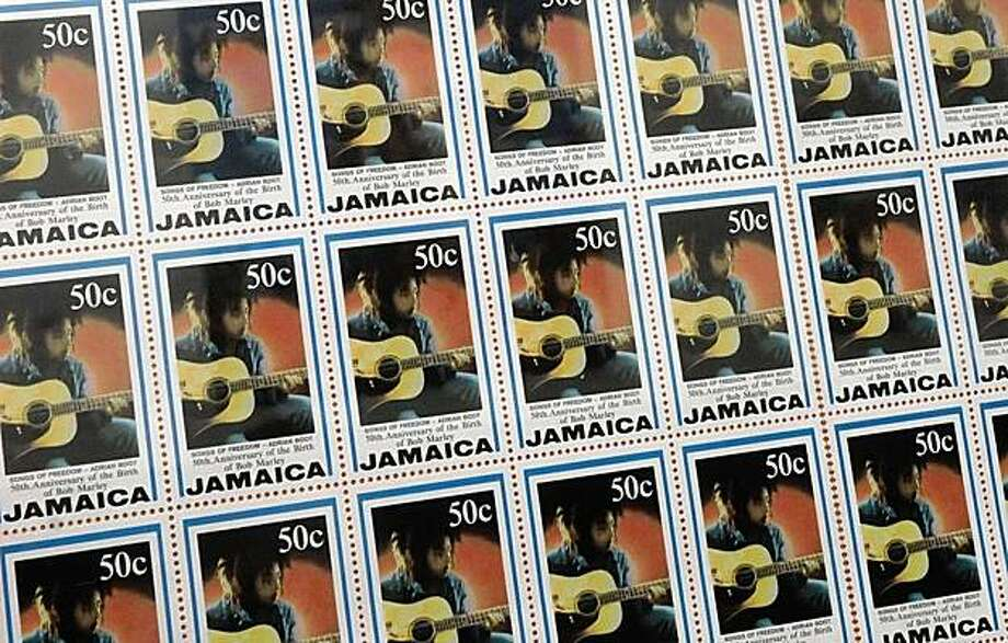 **ADVANCE FOR SUNDAY, NOV. 1** This June 16, 2009 photo shows postal stamps bearing the image of Bob Marley displayed inside Tuff-Gong Studios, where Marley recorded some of his best-known songs in Kingston, Jamaica. This year, Marley's family, with the help of a private equity firm and a team of lawyers, are trying to wrestle control of all rights to Marley's ubiquitous image from merchandise counterfeiters doing an estimated $600 million in annual sales across the globe. (AP Photo/Michael Sloley) Photo: Michael Sloley, AP