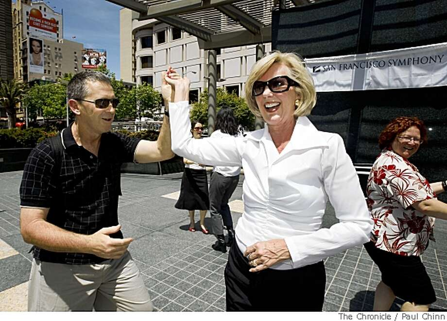 Patricia Sprincin, right, chair of the 2008 Black and White Ball, dances with Michael Bethell, a tourist visiting from Australia, when free dance lessons were offered at Union Square in San Francisco, Calif., on Thursday, May 15, 2008. The hour-long session was held to promote the bi-annual Black and White Ball fundraiser for the San Francisco Symphony which will be held on May 31.Photo by Paul Chinn / San Francisco Chronicle Photo: Paul Chinn, SFC