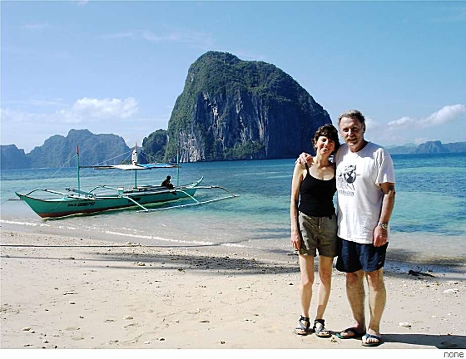 Joe DiBernardo, Walnut CreekEmail: jodibo@aol.comDaytime phone number: 925/998-8892Just back from: El Nido, Palawan Island, PhilippinesI went because: My wife Alison had a Qigong retreat in the Philippines, and we chose to visit Palawan afterwards in part due to the SF Chronicle article on 11/18/07.Don't miss: Islands, beaches, and rock formations in the Bacuit Archapelago near El Nido (on the island of Palawan).Don't bother: Spending more than two days in Manila.Coolest souvenir: Locally-made hand-carved wooden box with frogs on top from Asiano shop in Puerto Princesa, PalawanWorth a splurge: Staying at Dolarog Resort (mid-range). Cost includes your individual hut, most meals, and daily island-hopping by boatI wish I'd packed: Fewer clothes so that I was traveling lighter.Other comments: Carlos Celdran's walking tour in Intramuros (Manila) was informative and fun.Details of attached photo (if sent): Joe DiBernardo and wife Alison Tucker, taken near El Nido, Palawan Island, Philippines (overlooking Bacuit Archipelago) Photo: None