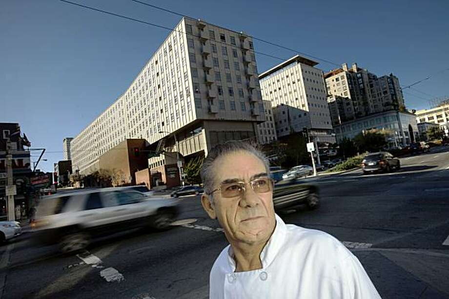 Eliseo Orozco stands outside Tommys Joint, where he has been employed for 40 years, on the corner of Geary and Van Ness October 28, 2009 in San Francisco, Calif. (Photograph by David Paul Morris/Special to the Chronicle) Photo: David Paul Morris, Special To The Chronicle