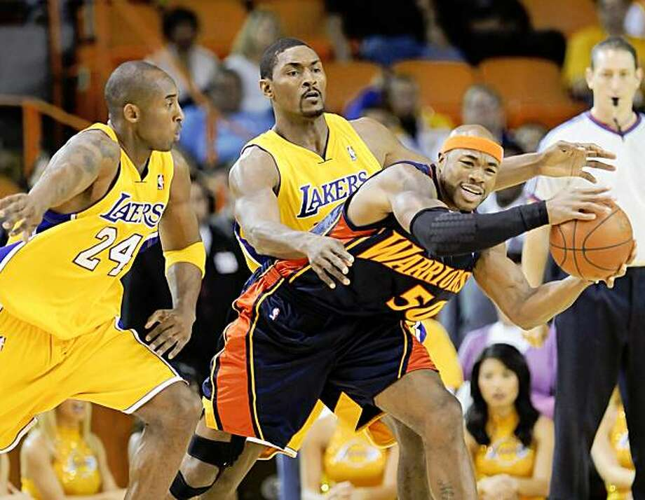 Los Angeles Lakers guard Kobe Bryant (24) and forward Ron Artest, center, double team Golden State Warriors forward Corey Maggette (50) in the first half of a preseason NBA basketball game, Friday, Oct. 9, 2009, in Inglewood, Calif. (AP Photo/Gus Ruelas) Photo: Gus Ruelas, AP