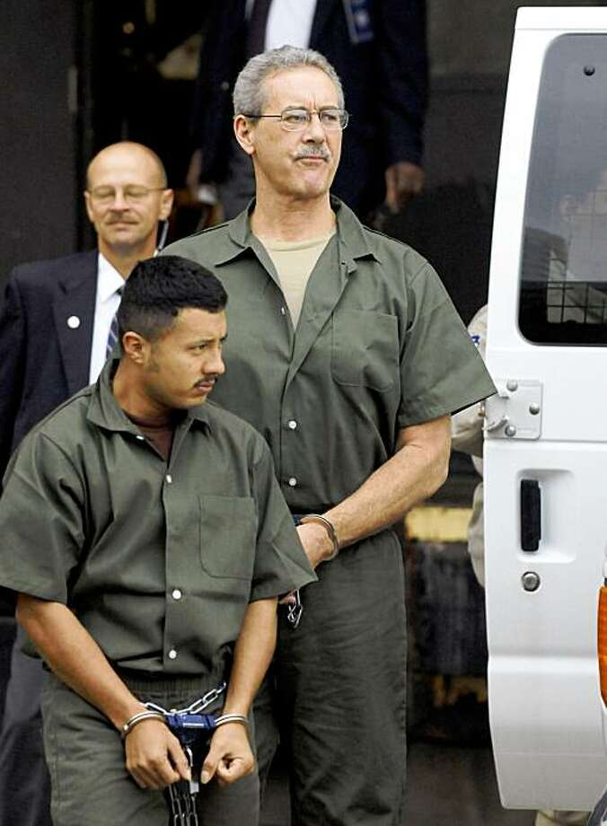 R. Allen Stanford, right, arrives at the federal courthouse with another unnamed prisoner for a hearing Wednesday, Oct. 14, 2009 in Houston. The financier faces 21 counts of conspiracy, fraud, bribery and obstruction of justice. (AP Photo/Pat Sullivan) Photo: Pat Sullivan, AP