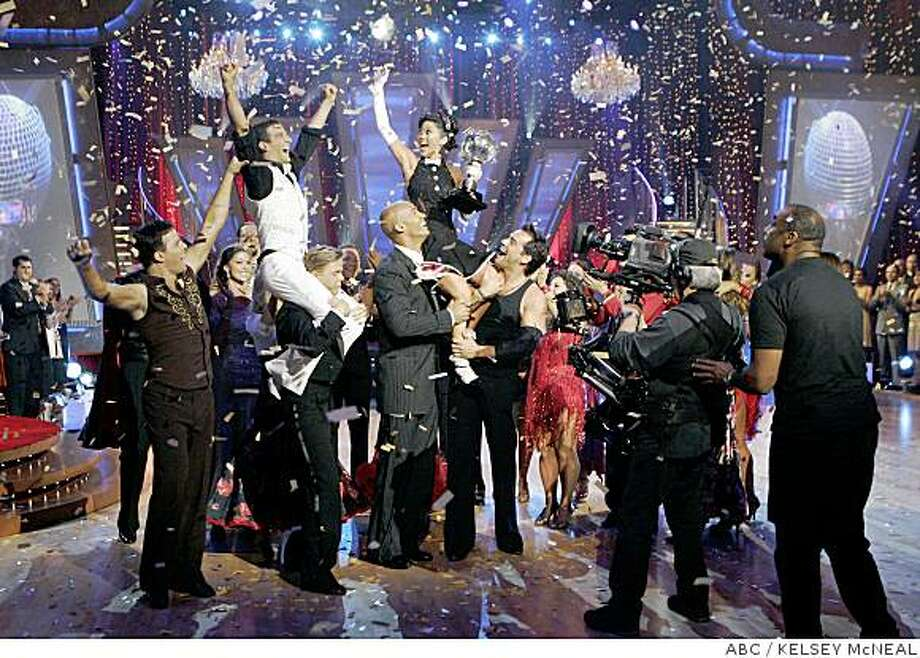 "In this image released by ABC-TV  Kristi Yamaguchi rides on the shoulders of Cristian de la Fuente and Jason Taylor as her professional partner Mark Ballas, rides on Derek Hough's shoulders surrounded by other cast members after they were crowned champion of ""Dancing with the Stars,"" in the two-part season finale, beginning Monday, MAY 19 and concluding Tuesday, MAY 20, 2008. (AP Photo/ABC/KELSEY McNEAL) Photo: KELSEY McNEAL, ABC"
