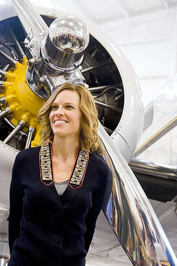 "Actress Hilary Swank poses in front of a Lockheed Electra airplane used in the production of the film ""Amelia"" during a news conference at the Essex County Airport in New Jersey, Friday, Oct. 16, 2009. (AP Photo/Charles Sykes) Photo: Charles Sykes, AP"