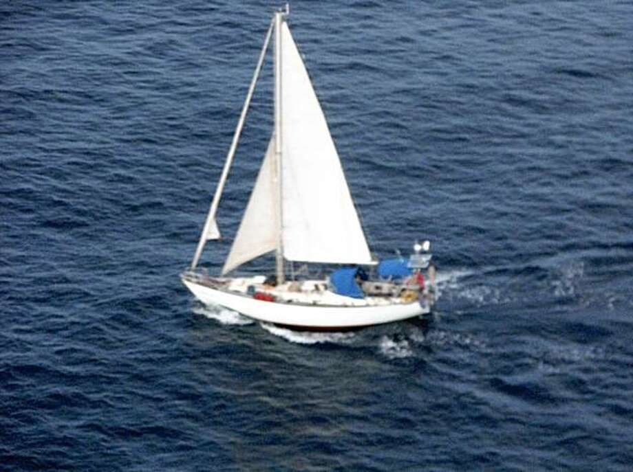 This handout image taken Wednesday Oct. 28, 2009 made available Thursday Oct. 29, 2009  by EU NAVFOR shows the yacht Lynn Rival belonging to a British couple apparently taken captive by pirates off the east coast of Africa. The British navy on Thursday found an empty yacht in international waters belonging to a missing British couple and a defense official said Somali pirates may have transferred them to another vessel.  International naval forces have been searching for the couple for days. Paul and Rachel Chandler were heading to Tanzania in their yacht, the Lynn Rival, when a distress signal was sent last Friday.  (AP Photo/ EU NAVFOR)  EDITORIAL USE ONLY Photo: AP