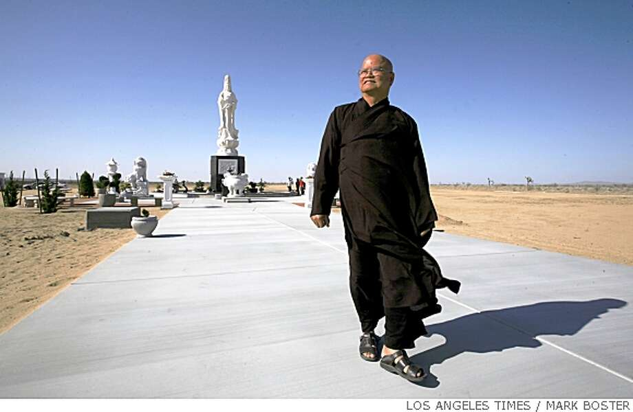 "Buddhist monk Thich Dang ""Tom"" Phap strolls down the sidewalk that will be used for meditation and walking prayers at the Buddhist Meditation Center in Adelanto, Calif. Illustrates BUDDHIST (category a) by Louis Sahagun (c) 2008, Los Angeles Times. Moved Friday, May 16, 2008. (MUST CREDIT: Los Angeles Times photo by Mark Boster.) Photo: MARK BOSTER, TPN"