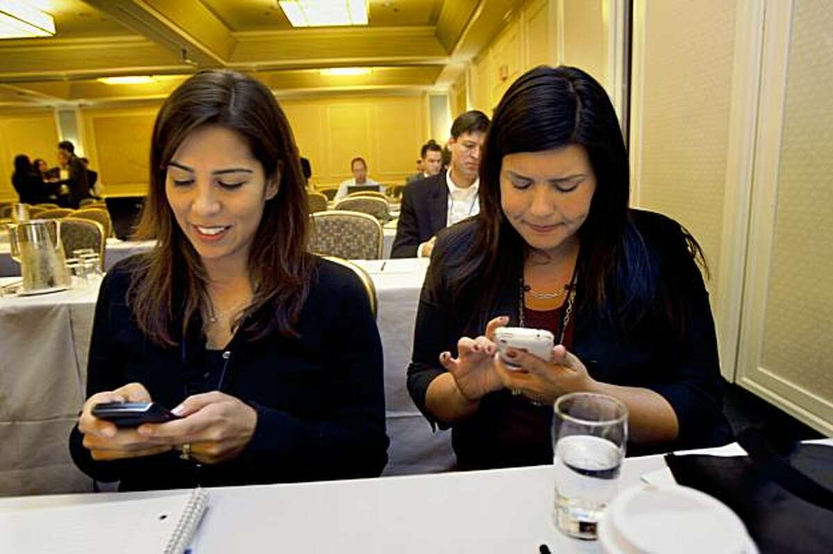 Kristi Fernandez (left) and Liz Walsh (right) from Sony at the Digital Media Conference in Hotel Kabuki in San Francisco, Calif., on Wednesday, October 28, 2009.