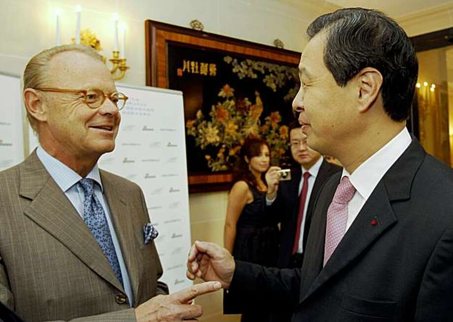 China's Ambassador to France Kong Quan, right, speaks with Patrick Thomas, CEO of the Hermes fashion house, in Paris, Thursday, Oct. 29, 2009. An association of French luxury labels has launched a new Web site to promote the brands in China, one of the sector's key emerging markets. In a lavish ceremony Thursday held in the Chinese embassy in Paris, the heads of Christian Dior, Chanel and dozens of other French labels celebrated the launch of the site, which is aimed at showcasing the houses to brand-hungry Chinese consumers. (AP Photo/Christophe Ena) Photo: Christophe Ena, AP