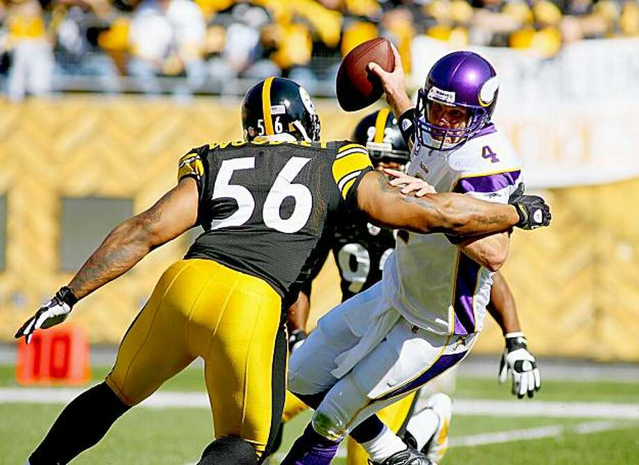PITTSBURGH - OCTOBER 25: Brett Favre #4 of the Minnesota Vikings is trapped by LaMarr Woodley #56 and James Harrison #92 of the Pittsburgh Steelers at Heinz Field on October 25, 2009 in Pittsburgh, Pennsylvania.  (Photo by Rick Stewart/Getty Images) Photo: Rick Stewart, Getty Images