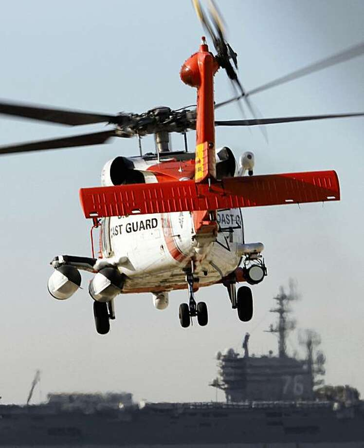 A U.S. Coast Guard MH-60 Jayhawk helicopter lifts off at the San Diego Coast Guard Station during a search effort Friday, Oct. 30, 2009, in San Diego.A Marine attack helicopter that collided with a Coast Guard search plane off Southern California was one of four helicopters flying in formation to deliver Marines to a training island. All nine crew members from the airplane and helicopter remain missing Friday. (AP Photo/Denis Poroy) Photo: Denis Poroy, AP