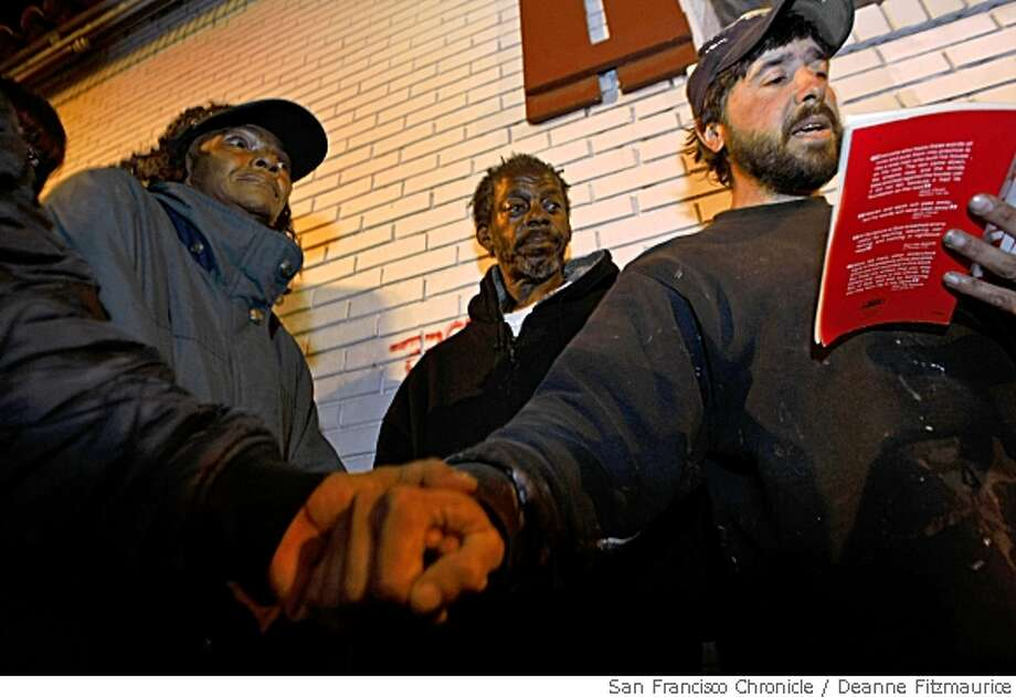 Vincent Pannizzo, 39, right, who quit working on his PhD at UC Berkeley to become a street preacher shows up near the corner of Fruitvale Ave and Foothill Blvd in Oakland, Calif. every night at 10 p.m. to pray with homeless people who gather there on May 21, 2008. Photo by Deanne Fitzmaurice / San Francisco Chronicle Photo: Deanne Fitzmaurice, SFC