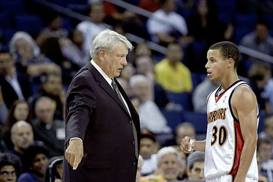 The Warriors's head coach, Don Nelson, speaks with rookie, Stephen Curry. The Golden State Warriors played the New Orleans Hornets at Oracle Arena in Oakland, Calif., on Thursday, October 22, 2009. The Warriors defeated the Hornets 126-92. Photo: Carlos Avila Gonzalez, The Chronicle