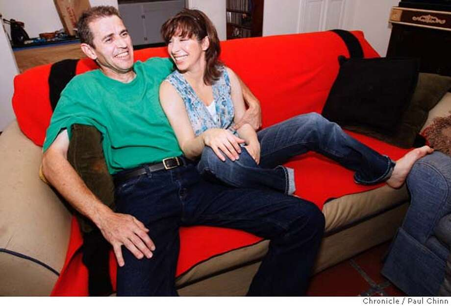 Erik and Kitty Stroul relax on their couch in Corte Madera, Calif., on Friday, May 16, 2008.  Photo by Paul Chinn / San Francisco Chronicle  Ran on: 05-25-2008 Photo: Paul Chinn