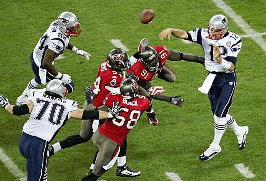 New England Patriots quarterback Tom Brady (12) gets a pass away during an NFL football game against Tampa Bay Buccaneers at Wembley Stadium, London, Sunday Oct. 25, 2009.  (AP Photo/Tom Hevezi) Photo: Tom Hevezi, AP