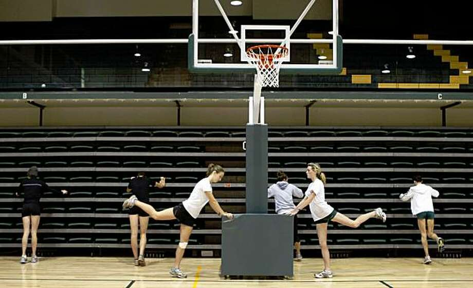 Cross country team of USF stretching at the University of San Francisco's War Memorial Gym in San Francisco, Calif., on Tuesday, October 13, 2009. Photo: Liz Hafalia, The Chronicle