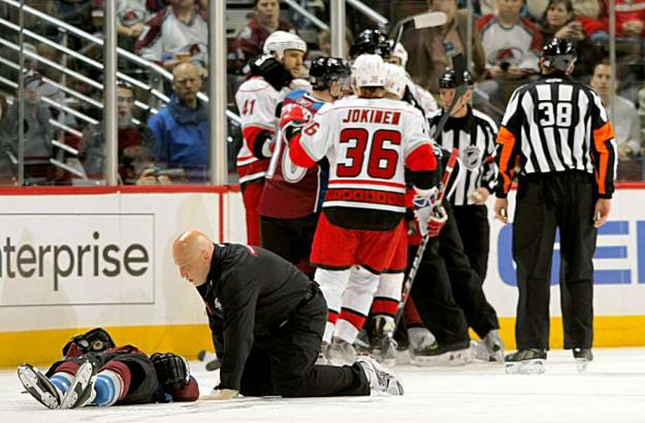 DENVER - OCTOBER 23:  Head athletic trainer Matthew Sokolowski attends to Darcy Tucker #16 of the Colorado Avalanche after he was hit by Tuomo Ruutu of the Carolina Hurricanes as the officials difuse the players during NHL action on October 23, 2009 in Denver, Colorado.  (Photo by Doug Pensinger/Getty Images) Photo: Doug Pensinger, Getty Images