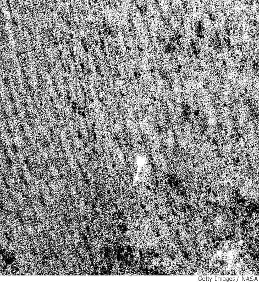 IN SPACE - MAY 25: In this handout photo provided by NASA/JPL-Caltech/University of Arizona, the Phoenix Mars Lander parachutes down to the surface of Mars on May 25, 2008 in the northern polar regions of Mars. The image was taken by the High Resolution Imaging Science Experiment (HiRISE) camera on NASA's Mars Reconnaissance Orbiter. The Phoenix Mars Lander is the newest hope in the search for signs of life on Mars. Less than half of the Mars missions have made successful landings. At a cost of $420-million, the Phoenix Mars Lander has flown 422-million-miles since leaving Earth last August.  (Photo by NASA/JPL-Caltech/University of Arizona via Getty Images) Photo: NASA, Getty Images