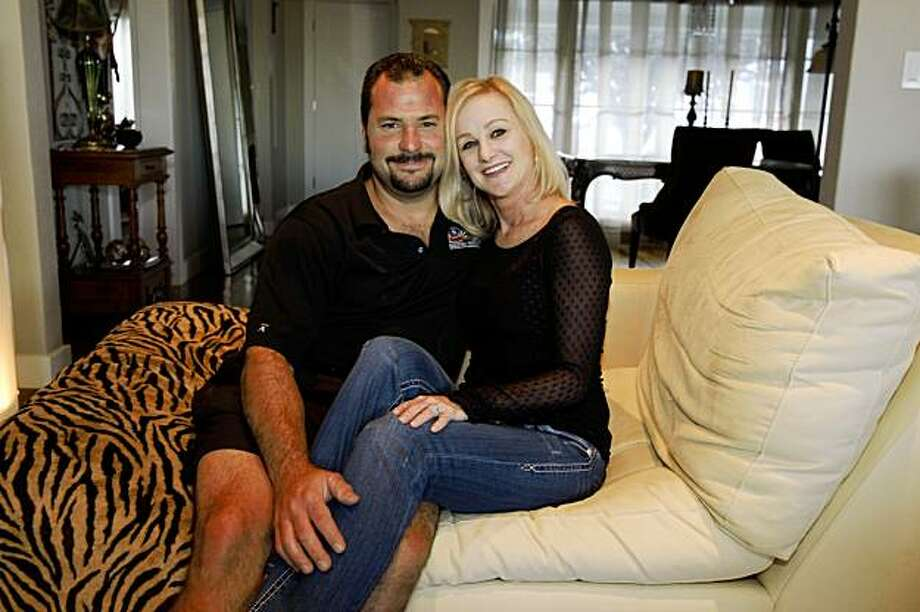 Greg Sanders and Debra DuPree share the couch at their home in San Mateo, Calif., on October 9. 2009. Photo: Frederic Larson, The Chronicle