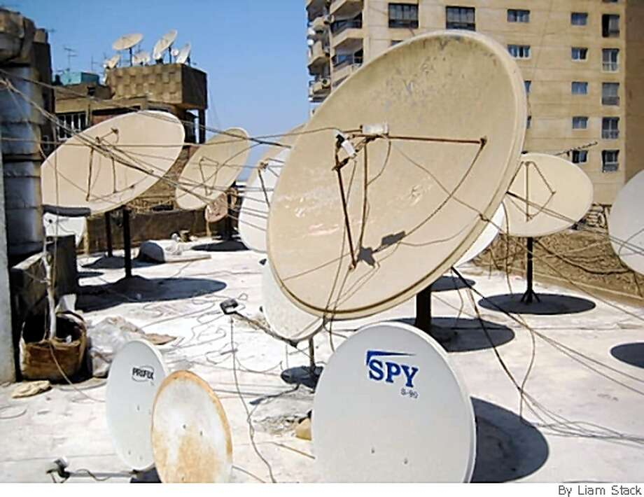 Satellite dishes sprout like mushrooms from the roofs of most Cairo buildings, a testament to the wild popularity of satellite television among Egypt's 76 million people. Photo: By Liam Stack