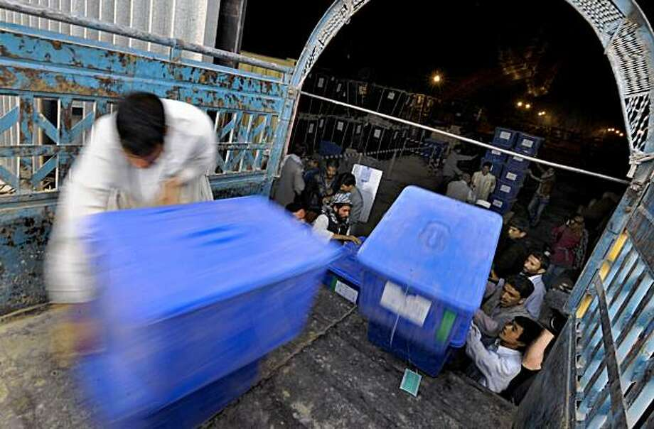 Afghan workers load ballot boxes and election materials onto private trucks at the Independent Election Commission (IEC) warehouse in Kabul on October 24, 2009, as ballot boxes and election materials are shipped out to provinces in preparation for the November 7, election run off. The Taliban called for a boycott of the upcoming polls in Afghanistan's fraud-tainted presidential election as top US and UN envoys predicted fewer problems with the second round. The run-off pits former foreign minister Abdullah Abdullah against incumbent  President Hamid Karzai, who came to power in late 2001 after the Taliban were toppled by US-led forces. Photo: ROMEO GACAD, AFP/Getty Images