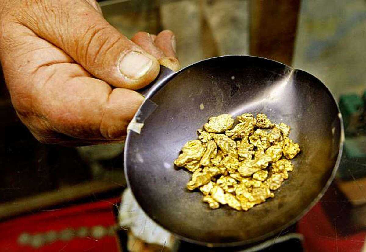 Brent Shock from the Gold Prospecting Adventures shows off some gold found on previous trips.