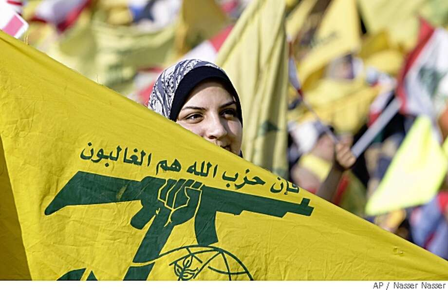 A woman holds a Hezbollah flag during a rally marking the eighth anniversary of Israel's troop withdrawal from southern Lebanon, at the southern suburb of Beirut, Lebanon, Monday, May 26, 2008.  Nasrallah has warned the Lebanese government not to use military force against the Shiite Muslim militant group. (AP Photo/Nasser Nasser) Photo: Nasser Nasser, AP