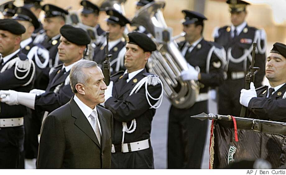 Newly-elected Lebanese President Michel Suleiman arrives at the Lebanese Parliament in Beirut, Lebanon, Sunday, May 25, 2008. Lebanon's newly elected president praised Hezbollah's fight against Israel Sunday but also said there needs to be a dialogue over the future of its arsenal, addressing key demands of both the Iranian-backed militants and their political rivals.. (AP Photo/Ben Curtis) Photo: Ben Curtis, AP