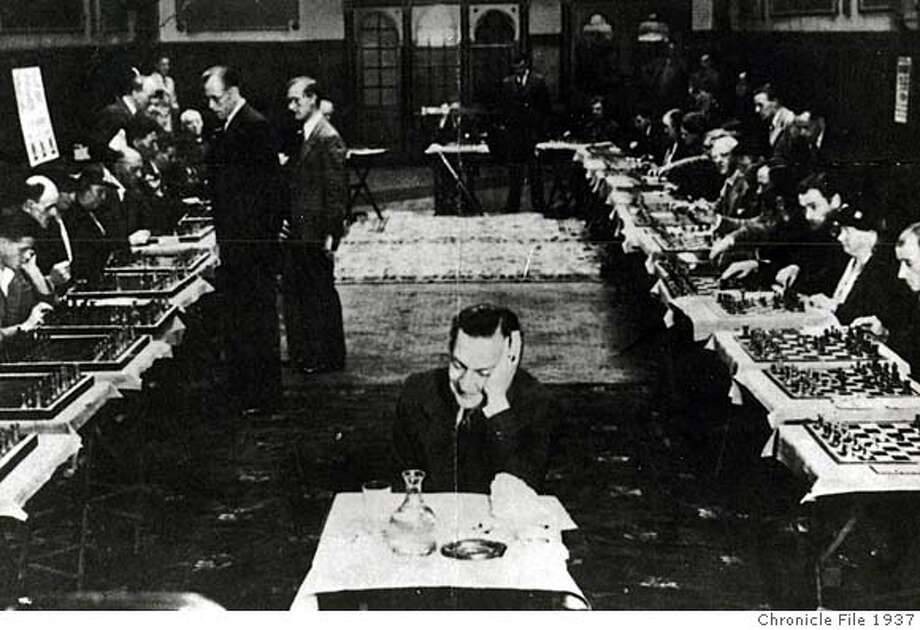 """walt_2210.jpg The Chronicle's George Koltanowski simultaneously plays 34 chess games, """"blindfolded,"""" in Edinburgh in 1937. Photo: Chronicle Archive"""