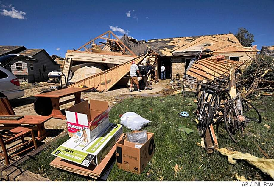 Residents remove personal items and valuables from their tornado damaged homes for the first time since a tornado hit the area earlier in the week, Saturday, May 24, 2008 in Windsor, Colo.,  (AP Photo/Bill Ross) Photo: Bill Ross, AP