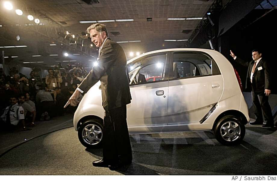 Tata Company Chairman Ratan Tata gestures during the launch of Tata Nano at the 9th Auto Expo in New Delhi, India, Thursday, Jan. 10, 2008. India's Tata Motors on Thursday unveiled its much anticipated US$2,500 car, an ultracheap price tag that suddenly brings car ownership into the reach of tens of millions of people across the world. (AP Photo/Saurabh Das) Photo: Saurabh Das, ASSOCIATED PRESS