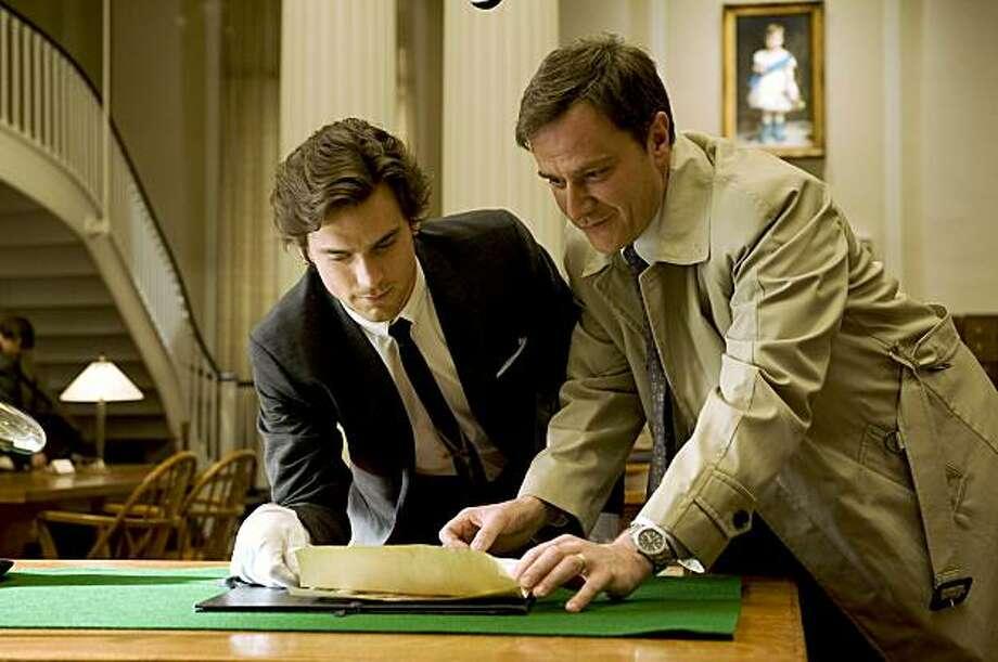 "WHITE COLLAR -- ""Pilot"" -- Pictured: (l-r) Matthew Bomer as Neal Caffrey, Tim Dekay as Peter Burke -- USA Network Photo: David Giesbrecht WHITE COLLAR -- ""Pilot"" -- Pictured: (l-r) Matthew Bomer as Neal Caffrey, Tim Dekay as Peter Stokes -- USA Network Photo: David Giesbrecht Photo: David Giesbrecht, USA Network"