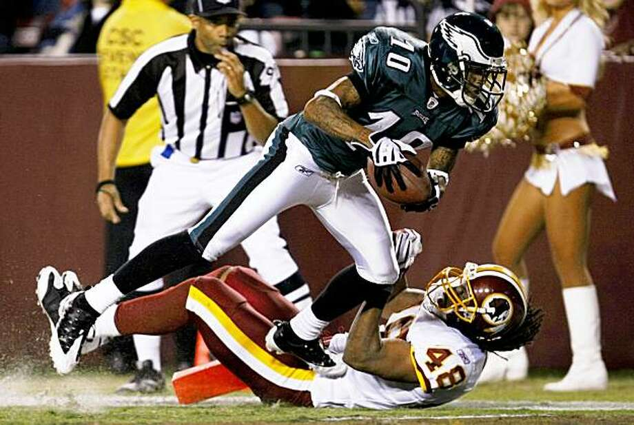 LANDOVER, MD - OCTOBER 26:  DeSean Jackson #10 of the Philadelphia Eagles trips over Chris Horton #48 of the Washington Redskins to score a touchdown in the second quarter of the game at FedEx Field October 26, 2009 in Landover, Maryland. (Photo by Win McNamee/Getty Images) Photo: Win McNamee, Getty Images