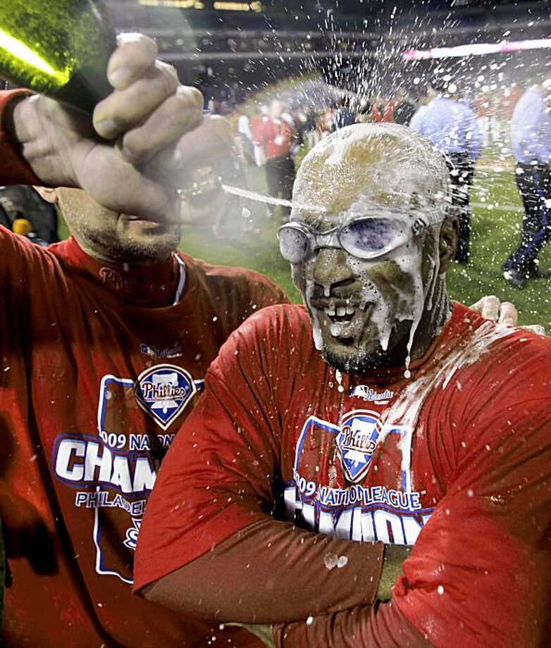 Philadelphia Phillies' Jimmy Rollins is sprayed with champagne after winning Game 5 of the National League Championship baseball series over the Los Angeles Dodgers Thursday, Oct. 22, 2009, in Philadelphia. The Phillies defeated the Dodgers 10-4 to win the National League Championship. (AP Photo/David J. Phillip) Photo: David J. Phillip, AP